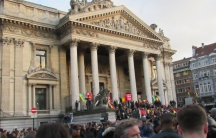 Crowds gather on the steps of the old Brussels stock exchange, Place de la Bourse.