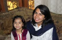 Umaima Awan sits with her mother, Um-E Salma, at the family's house in Jauharabad, Pakistan.