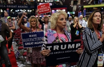People cheer in the Quicken Loans Arena during the Republican National Convention