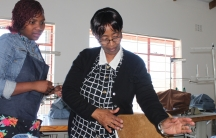 Nobom Ntsuntswana (right) supervises a sewing project at the skills training center where she works in Cape Town.
