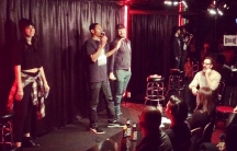 Host Brian Moses stands between two warring comics at the Comedy Store's Roast Battle.