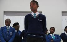 Siyathemba, a junior at COSAT, delivers a speech during student council elections.