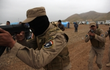 Policemen who fled Mosul train in a camp near Erbil to try to take their city back from ISIS.