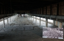 The sixth floor of the old Studebaker factory, about a fifth of a mile in length, in downtown Sound Bend, Indiana. A large cardboard photo shows the way the factory looked in the early 20th century, with almost 30,000 workers building cars at the Studebak