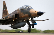 An Iranian Air Force F-5F fighter plane takes off during manoeuvres in southern Iran.