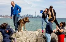 Iranian refugee families enjoy a Sunday picnic at Toronto Humber Bay Park.