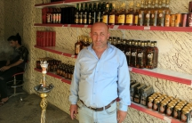 Ibrahim Noel reopened his liquor store in Qaraqosh, northern Iraq, after he said ISIS demolished it.