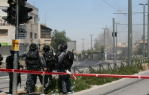 Tensions are high in the capital after 16-year-old Muhammed Abu Khdeir was was killed in an apparent revenge killing for three slain Jewish teens. Police watch as residents of the east Jerusalem neighborhood Shuafat set dumpsters on fire, throw rocks and