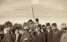 Mayor Husseini (center, wearing a fez), with two British infantry sergeants the morning of the surrender of Jerusalem, December 9th, 1917