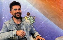 Colombian singer Juanes, speaks during an interview with Reuters in Medellín