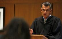 Los Angeles Superior Court Judge Craig Mitchell talks to a defendant.