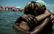 Brazilians embrace at Piscinão de Ramos, an artifical lake next to Guanabara Bay.