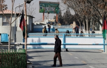 Afghan security forces stand guard at the entrance gate of the Intercontinental Hotel a day after an attack in Kabul, Afghanistan, Jan. 22, 2018.