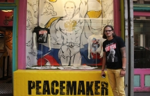 "Julius Kacinskis outside of ""Peacemaker,"" the pop-up shop on East 20th Street in Manhattan where he sells Vladimir Putin t-shirts that he designed. ""People portray Putin as a mean guy,"" Kacinskis says, ""so we gotta educate people."""