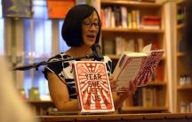 """Author Kathryn Ma reading from her first novel, """"The Year She Left Us,"""" at a bookstore in Berkeley, California."""