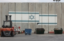 An Israeli flag is painted on one of the walls on the Israeli side of the Kerem Shalom crossing into Gaza.