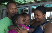 The Mraqisa family (L to R): father Lindela, son Bukho, daughter Ongeziwe and mother Nosicelo outside their home in Gugulethu Township.