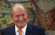 Spain's King Juan Carlos smiles in one of his latest audiences at the Zarzuela Palace outside Madrid, May 27, 2014. Spain's Prime Minister Mariano Rajoy said on June 2, 2014 that King Juan Carlos will abdicate and Prince Felipe will take over the throne.