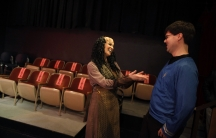 "Performer Jacqueline Salamack (L) jokes with an audience member after a performance of ""A Klingon Christmas Carol"" in Chicago, December 20, 2012."
