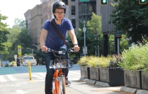 Derrick Ko, co-founder and CEO of Spin, rides one of his bikes in downtown Seattle. Spin currently has a permit to place 500 ride share bikes in Seattle.Derrick Ko, co-founder and CEO of Spin, rides one of his bikes in downtown Seattle. Spin currently has