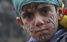 "A Kurdish boy with ""Kobane"" written on his forehead takes part in a celebration in the Syrian Kurdish city of Qamishli, after it was reported that Kurdish forces took control of the Syrian town of Kobani, January 27, 2015."