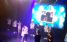 Screenshot of a hug at a K-pop band concert in Malaysia