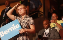 """A woman holds a """"Bernie!"""" sign at the Democratic National Convention"""