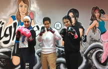 Lina Khalifeh (center), Batoul Jaikat (right) and one of the students at the SheFighter studio in Amman, Jordan.