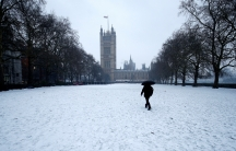 A man walks in the snow next to the Houses of Parliament in London on March 1. Brtain and much of the rest of Europe have been hit with a late winter blast linked to extreme warming in the Arctic.