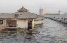 An abandoned mosque outside the seawall in Muara Baru, Jakarta. The city is sinking as a result of massive groundwater extraction, and the problem is especially bad in Muara Barus, which is already below sea level.