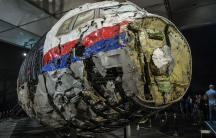 The reconstructed wreckage of the MH17 airplane is seen after the presentation of the final report into the crash.