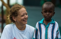 Ane Bjøru Fjeldsæter, an MSF Mental Health Manager from Norway, poses with six-year-old Ebola survivor Patrick.