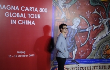Chinese visitor poses to mark Magna Carta's first visit to China