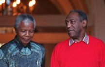 Bill Cosby and Nelson Mandela, then President of South Africa, appear before the press on March 20, 1997 in Cape Town. During his visit, Cosby gave a benefit performance on Robben Island for then visiting first lady Hillary Rodham Clinton, Mandela and Uni
