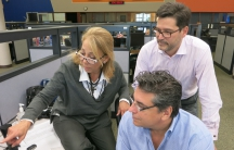 Malule González (left) and her team work on the news rundown in the Radio and TV Martí newsroom in Miami.