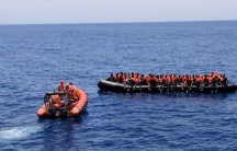 Save the Children workers rescue migrants on a boat in the Mediterranean off the coast of Libya