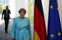 German Chancellor Angela Merkel arrives for a statement in Berlin after Britain voted to leave the European Union.