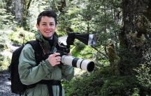 Ben Mirin photographing birds in New Zealand's Fiordland