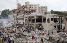 Somali government forces and civilians gather at the scene of an explosion in KM4 street in the Hodan district of Mogadishu, Somalia on Oct. 15, 2017.