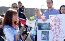 Sharlee Mullins Glenn speaks to demonstrators outside the Office of Homeland Security in West Valley City, Utah in May.