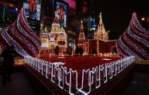 People watch festive decorations depicting the Moscow Kremlin for the New Year and Christmas season at Kievsky Railway Station in Moscow, Russia December 28, 2017.