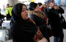 A woman waits for family to arrive at John F. Kennedy International Airport in Queens, New York, on Jan. 28.