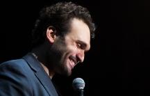 Lebanese-American comedian Nemr. He's as comfortable performing in Saudi Arabia as he is in the US.