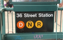 A tilde added to the sign for the N subway line in Sunset Park, a heavily Hispanic neighborhood in Brooklyn, New York.