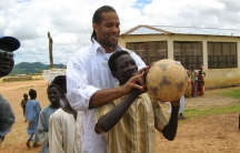 Former NBA player Ira Newble at a refugee camp on the Chad/Sudan border.