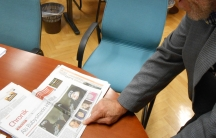 Peter Slanar, principal of Vienna's Higher Commercial Vocational School, looks at a news story about his former student Samra Kesinovic who joined up with ISIS in Syria.