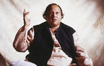 Nusrat Fateh Ali Khan, the Pakistani singer who is known for bringing Qawwali music to a global audience.