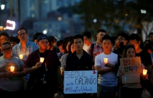 People attend a candlelight vigil in solidarity for the victims of the Orlando gay nightclub mass shooting, in Seoul, South Korea.