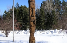 A carved wooden statue of St. Urho greets visitors as they enter the northeast Minnesota town of Finland.