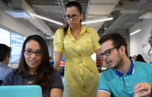 Entrepreneur Vivian Vargas (center) chose to start her business in Puerto Rican to be closer to Latin American markets.